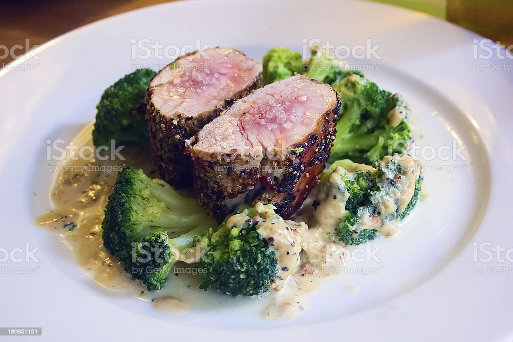 beef steak fillet with broccoli on white plate royalty-free stock photo