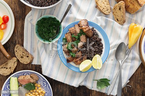 655793486istockphoto Beef steak grilled with black quinoa in a plate on a dark wooden table 834116872