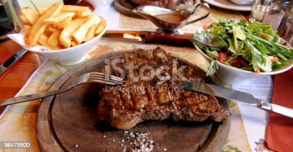Beef Steak On Wooden Plate With Chips And Salad Stock Photo & More Pictures of Beef