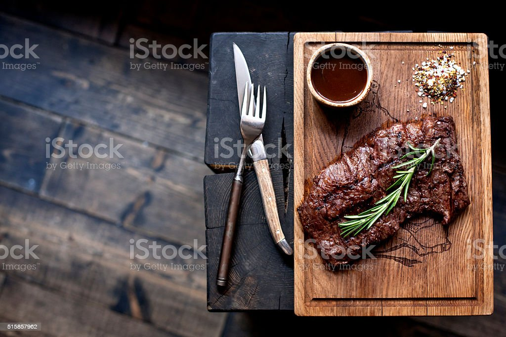Beef steak. Piece of Grilled BBQ beef  in spices stock photo