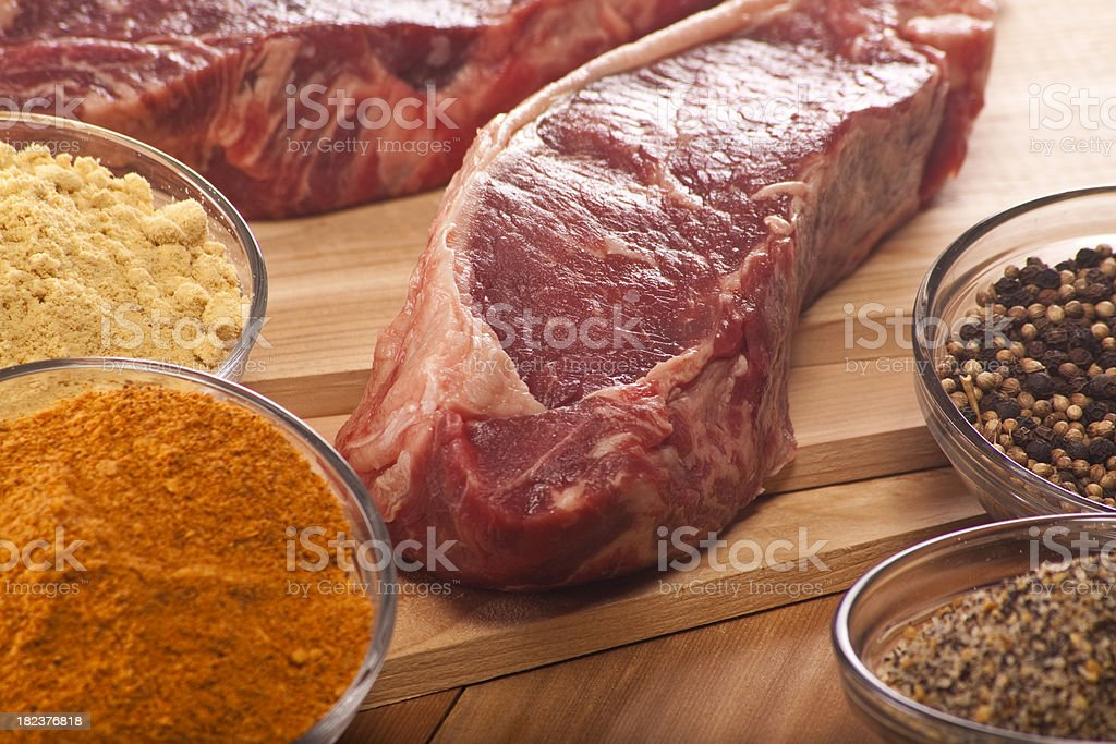 Beef Steak Raw with Spices royalty-free stock photo