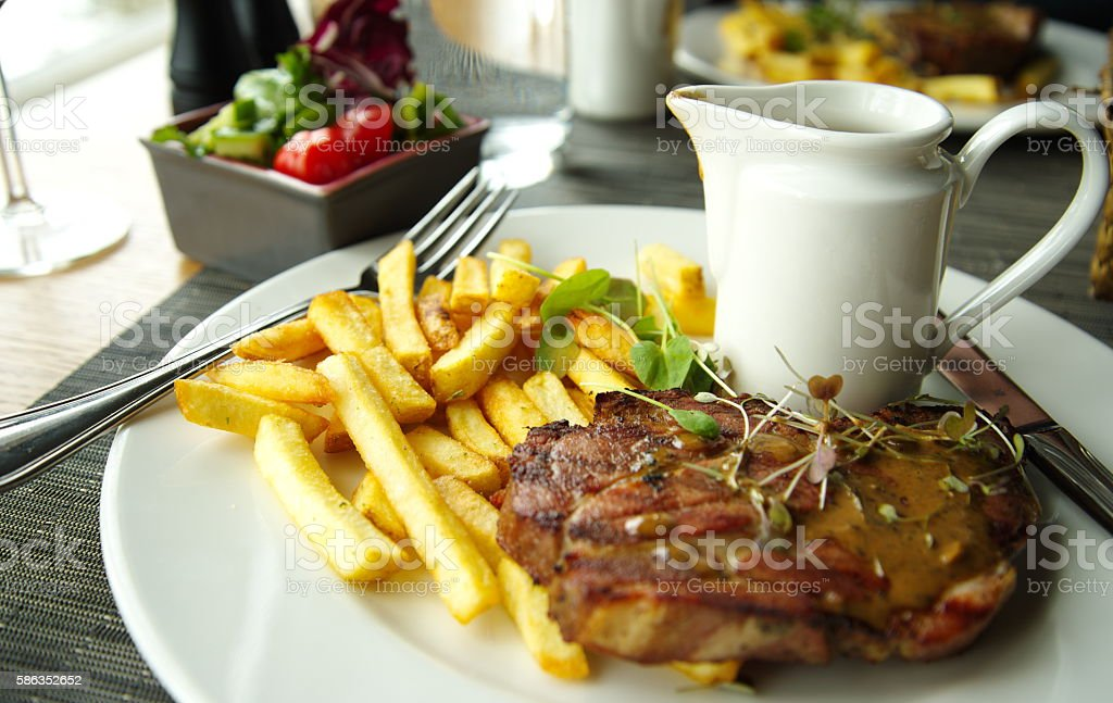 beef steak with french fried in white plate stock photo