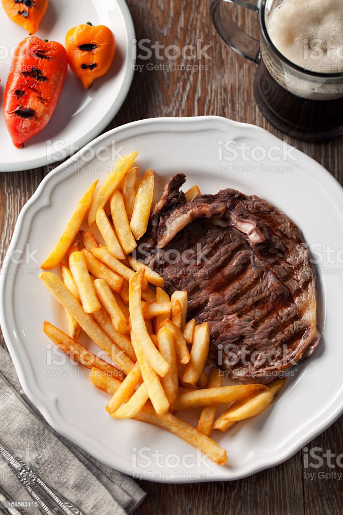 Beef steak with French fries stock photo