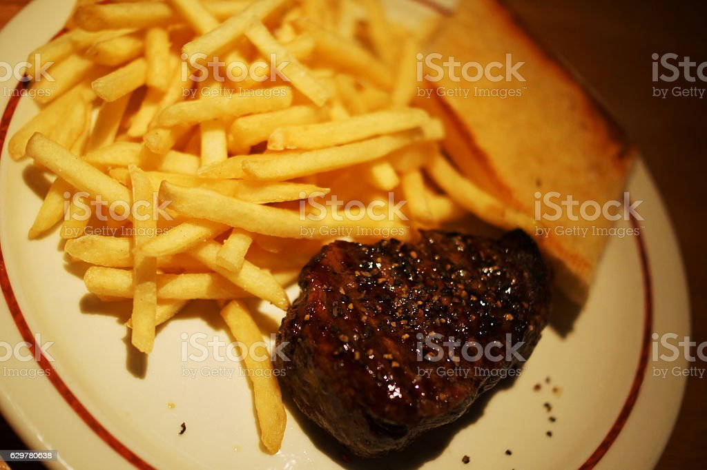 Beef steak with Pommes frites stock photo