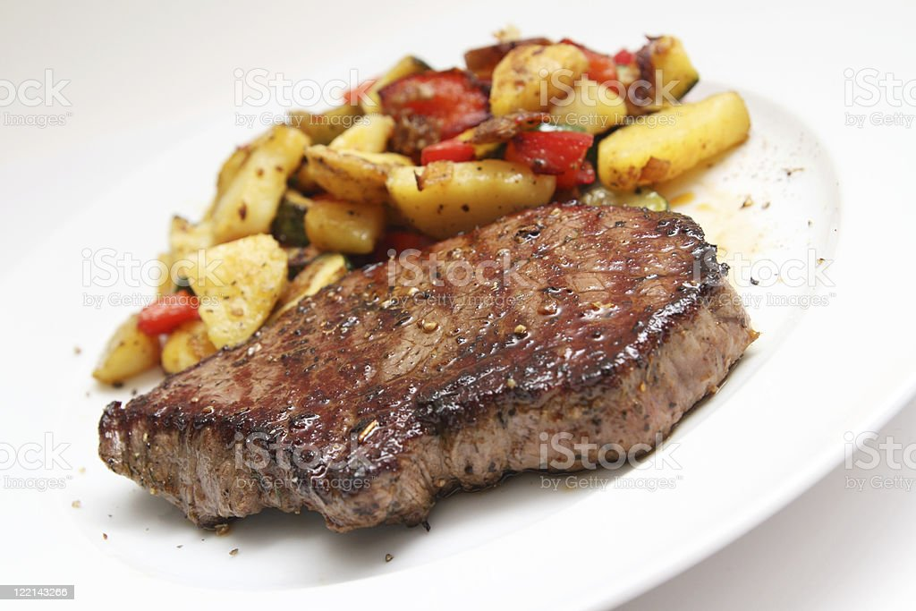 Beef steak with potaoes and mixed vegetable stock photo