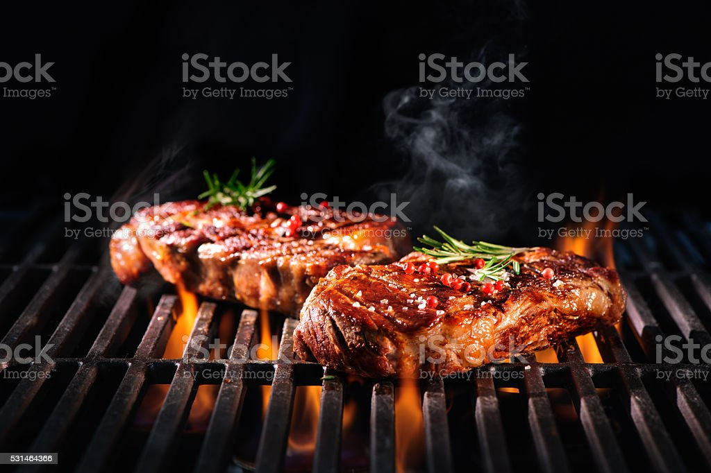 Beef steaks on the grill royalty-free stock photo