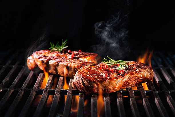 beef steaks on the grill - barbecue grill stock photos and pictures