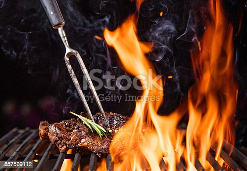 istock Beef steaks on the grill with flames 857569112