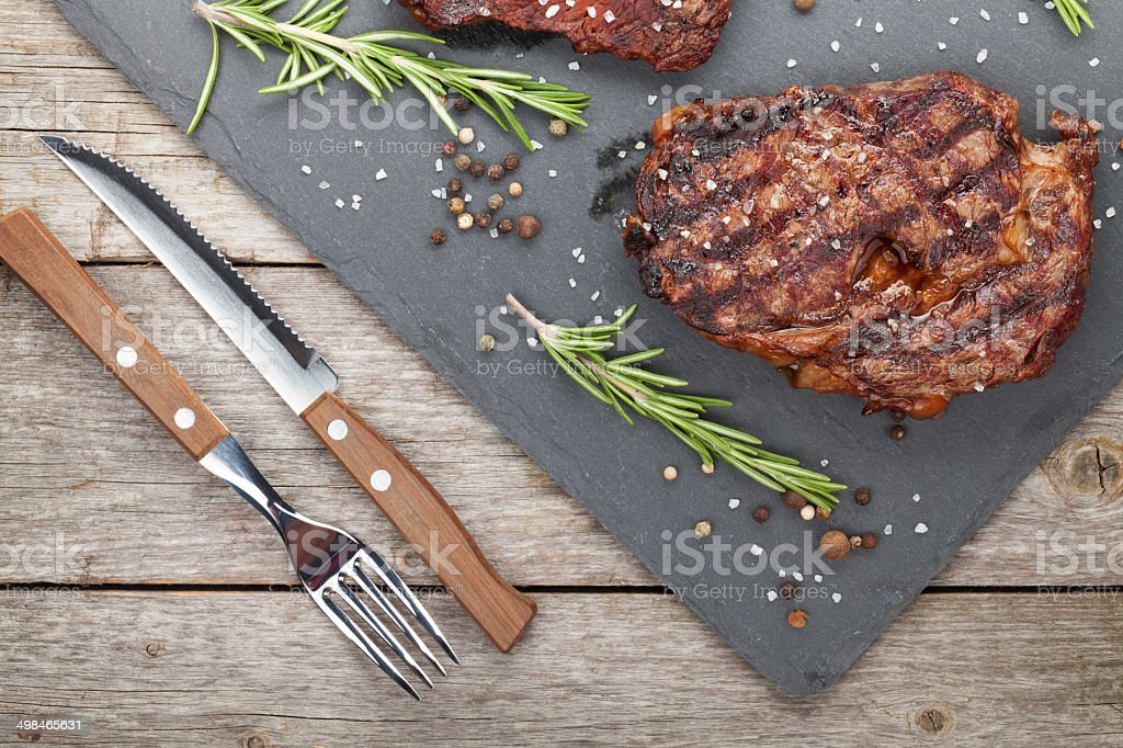 Beef steaks with rosemary and spices stock photo