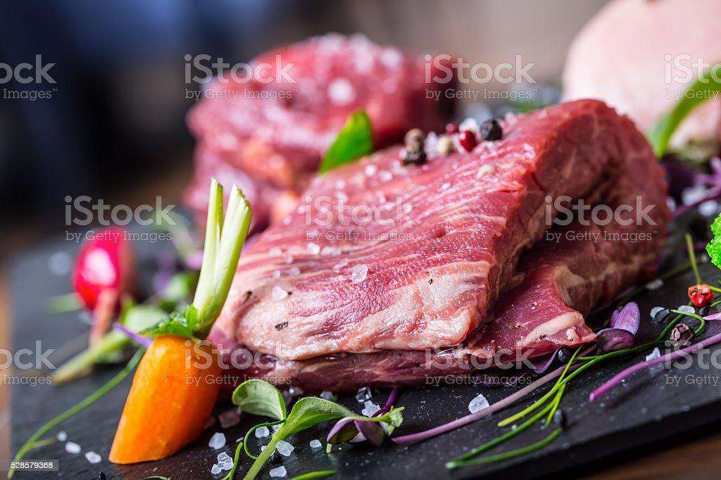 Beef steak.Sirloin steak.T-Bone steak. Flank steak. Duck breast. Vegetable decoration. stock photo