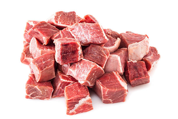 Beef Stew Meat Raw Beef Stew Meat Raw - diced raw blade or chuck steak, on white background. stew stock pictures, royalty-free photos & images