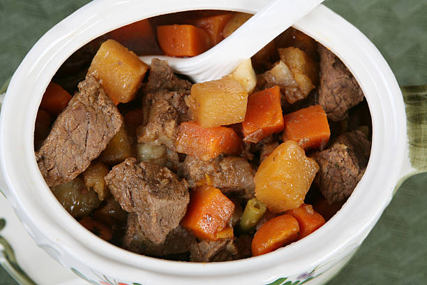 Beef stew Beef cubes and vegetables in a tureen. pot au feu stock pictures, royalty-free photos & images