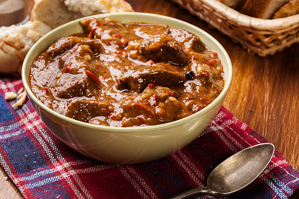 Beef stew served with crusty bread Beef stew served with crusty bread in a bowl goulash stock pictures, royalty-free photos & images