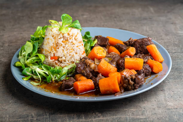 Beef stew served with rice stock photo