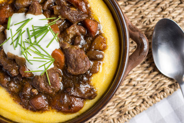 beef stew with mushrooms, carrots and corn polenta - serbia stock photos and pictures