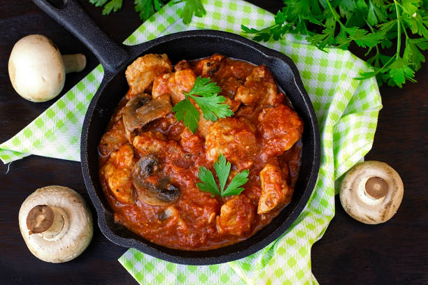 Beef stew with mushrooms in tomato sauce Beef stew with mushrooms in tomato sauce with parsley ragout stock pictures, royalty-free photos & images