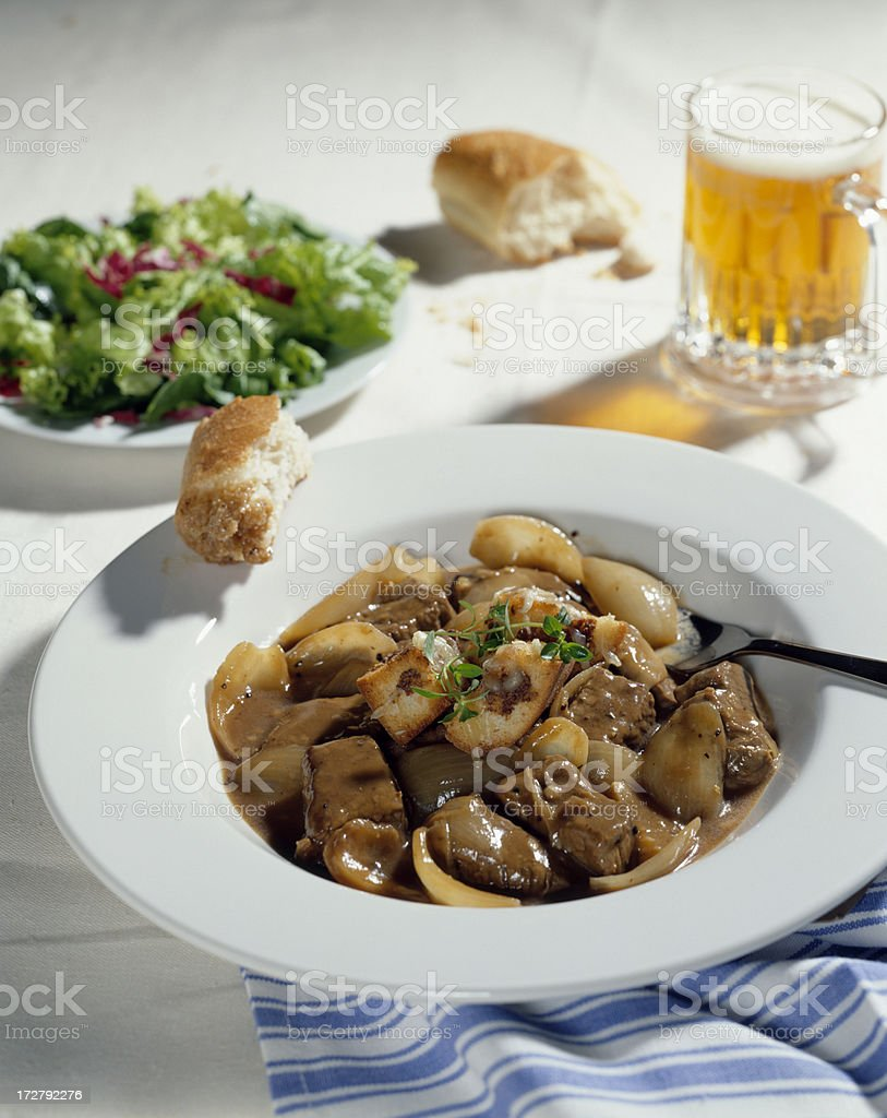 Beef Stew with salad and beer stock photo