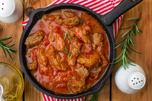 Beef stew with tomato sauce and cream Beef stew with tomato sauce and cream and rosemary beef stew stock pictures, royalty-free photos & images