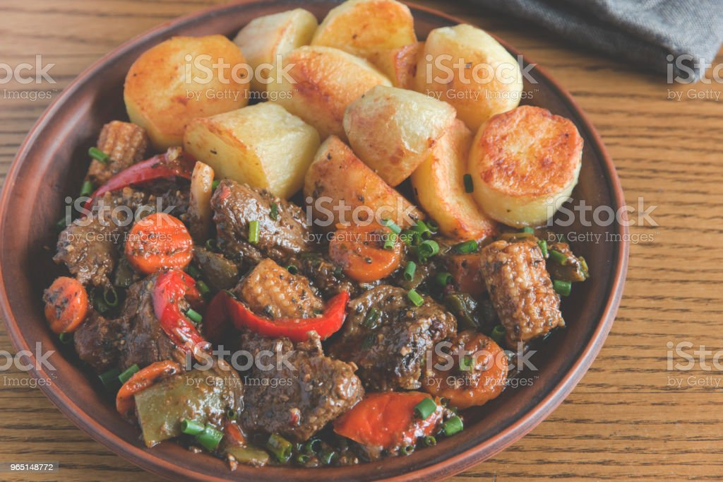 beef stew with vegetables and fried potatoes royalty-free stock photo