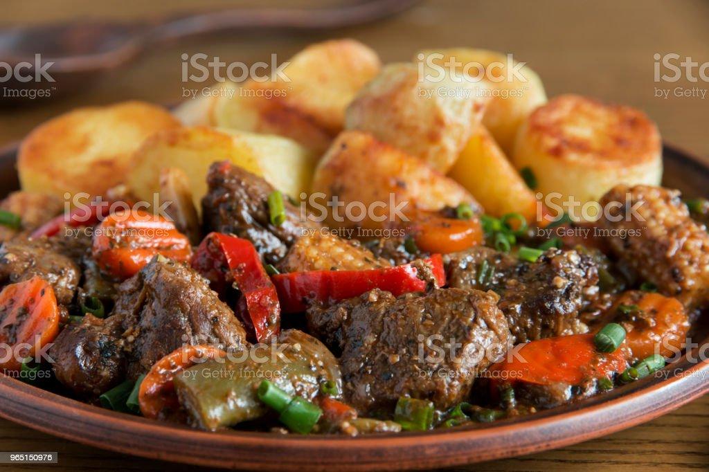 beef stew with vegetables and fried potatoes zbiór zdjęć royalty-free