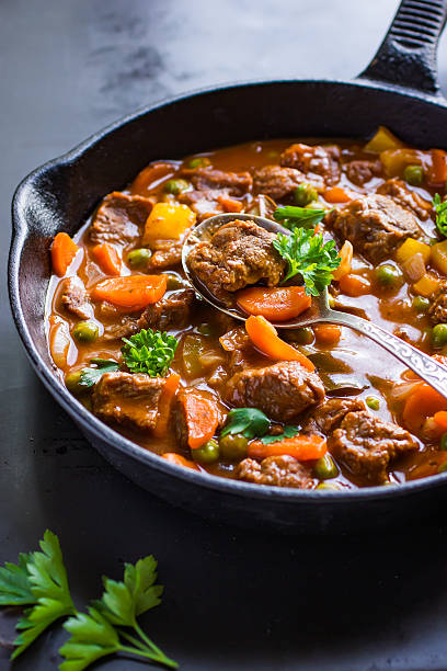 beef stew with vegetables beef stew with vegetables on dark background, goulash stock pictures, royalty-free photos & images