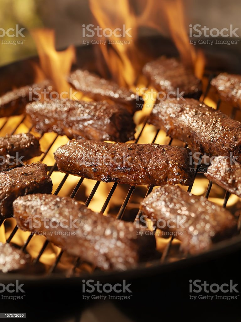 Beef Strip Steaks on an outdoor BBQ stock photo