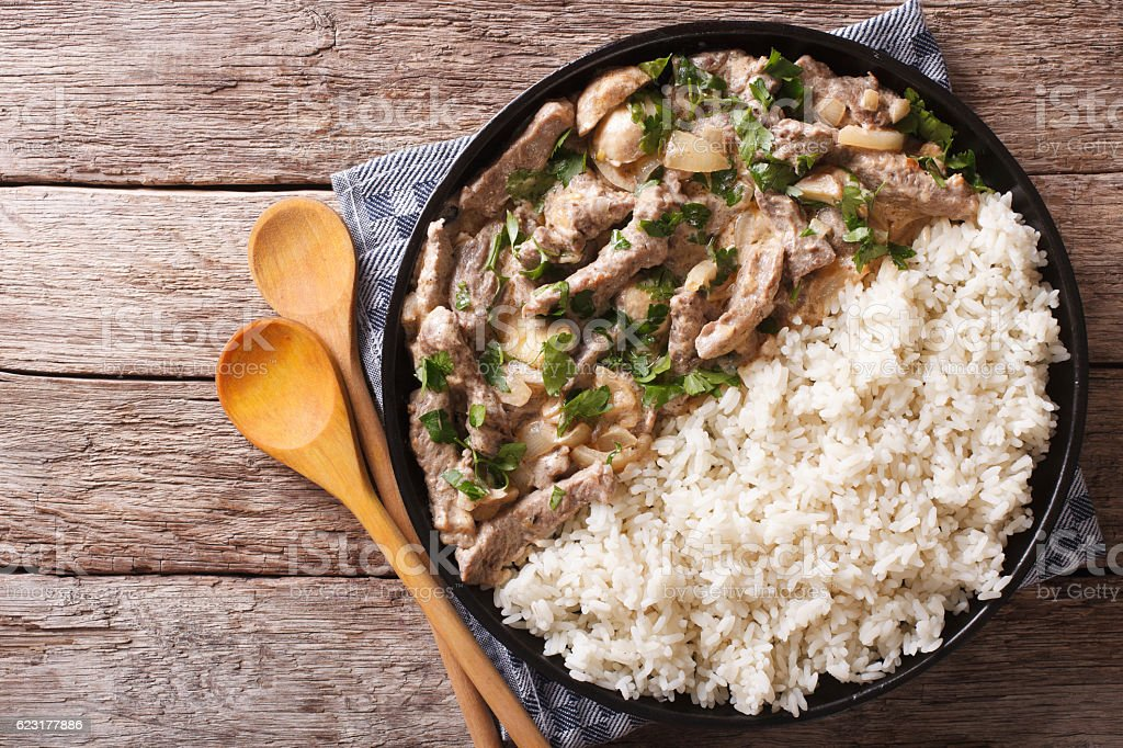 beef stroganoff and rice close-up on plate. horizontal top view stock photo
