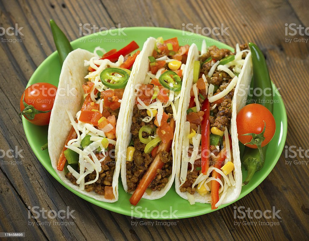 Beef taco on the plate with vegetables stock photo