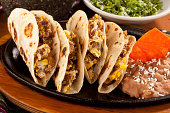 Beef Tacos With Scrambled Eggs and Refried Beans in Flour tortilla, Machacado Tacos,Tex Mex Food