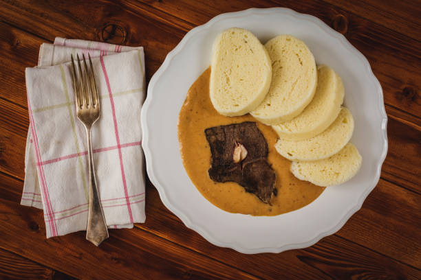 Beef tenderloin and sauce Czech cuisine beef tenderloin and dumplings sauce from vegetables and cream czech culture stock pictures, royalty-free photos & images