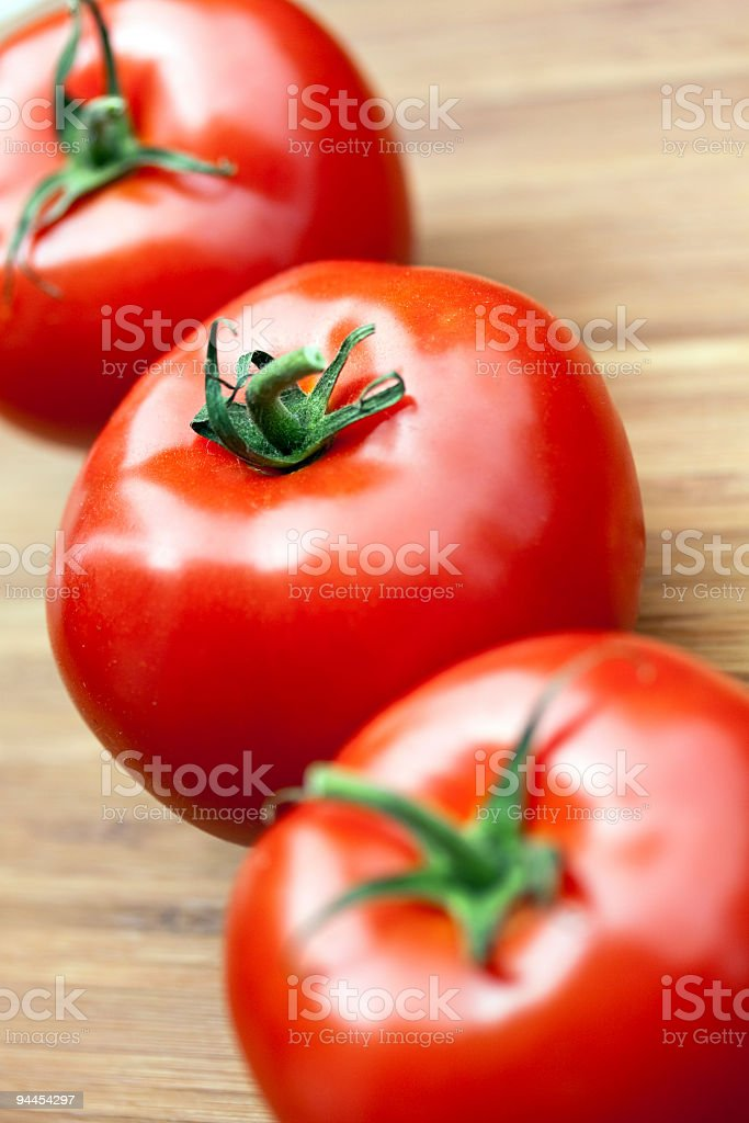 beef tomatoes on the wooden background royalty-free stock photo