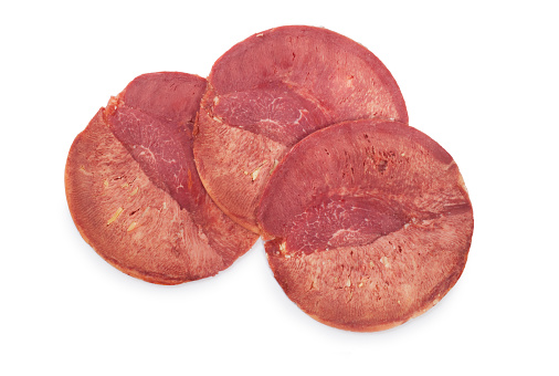 Slices of pressed ox tongue cut out against a white background