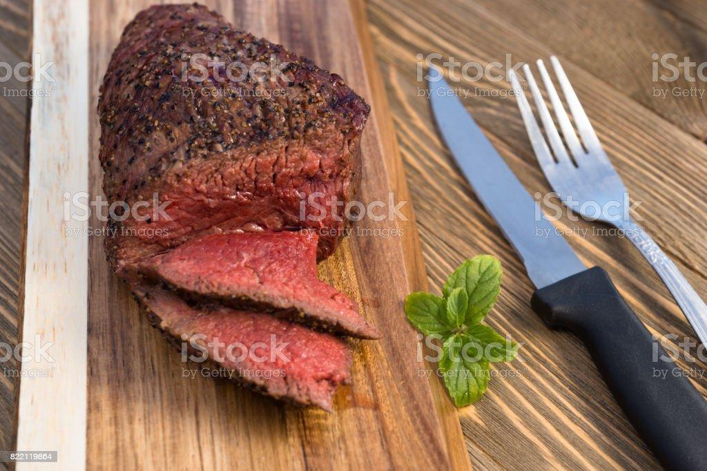 Beef Top Sirloin Steak Roast Sliced Coooked Medium Rare stock photo