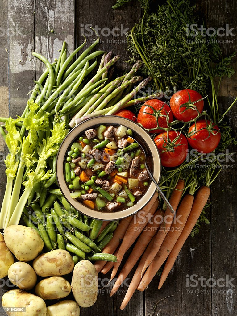 Beef Vegetable Soup with Ingredients stock photo