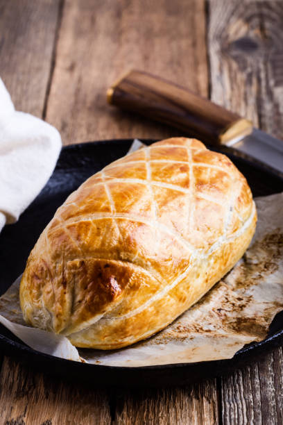Beef Wellington  in cast iron skillet stock photo