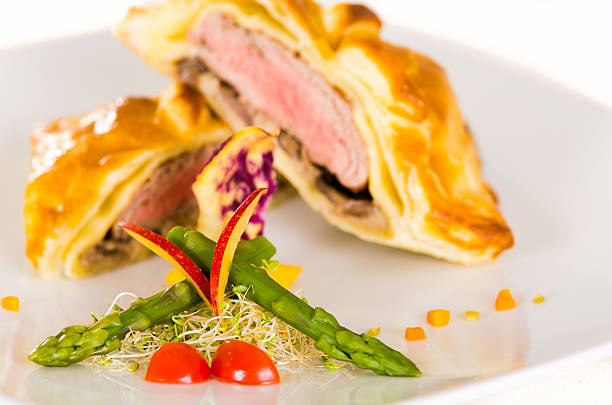 Beef Wellington with salad stock photo
