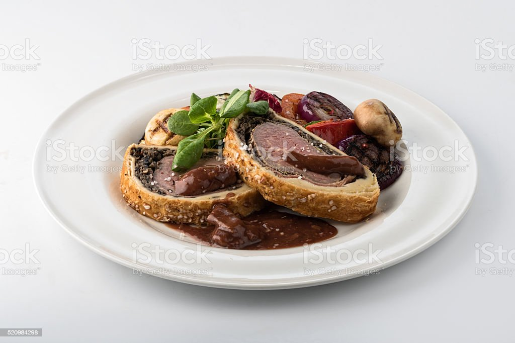 Beef Wellngton with vegetables stock photo