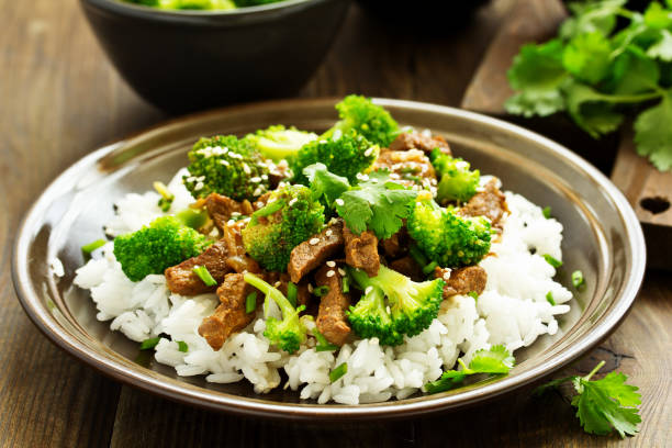 Beef with broccoli and rice. Asian cuisine. stock photo