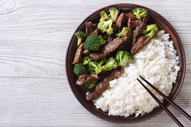 beef with broccoli and rice on the table. top view stock photo