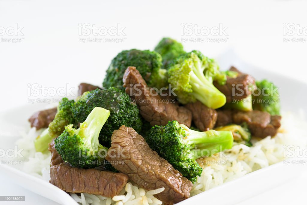 beef with broccoli selective focus stock photo