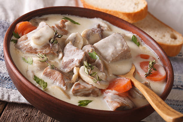 Beef with mushrooms in cream sauce in a bowl. horizontal - Photo