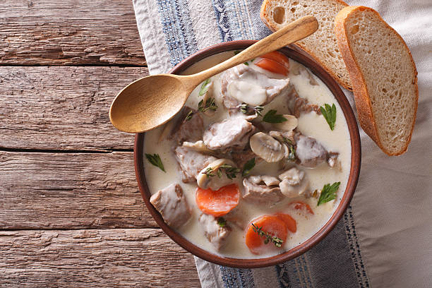 Beef with mushrooms in cream sauce in bowl. horizontal - Photo