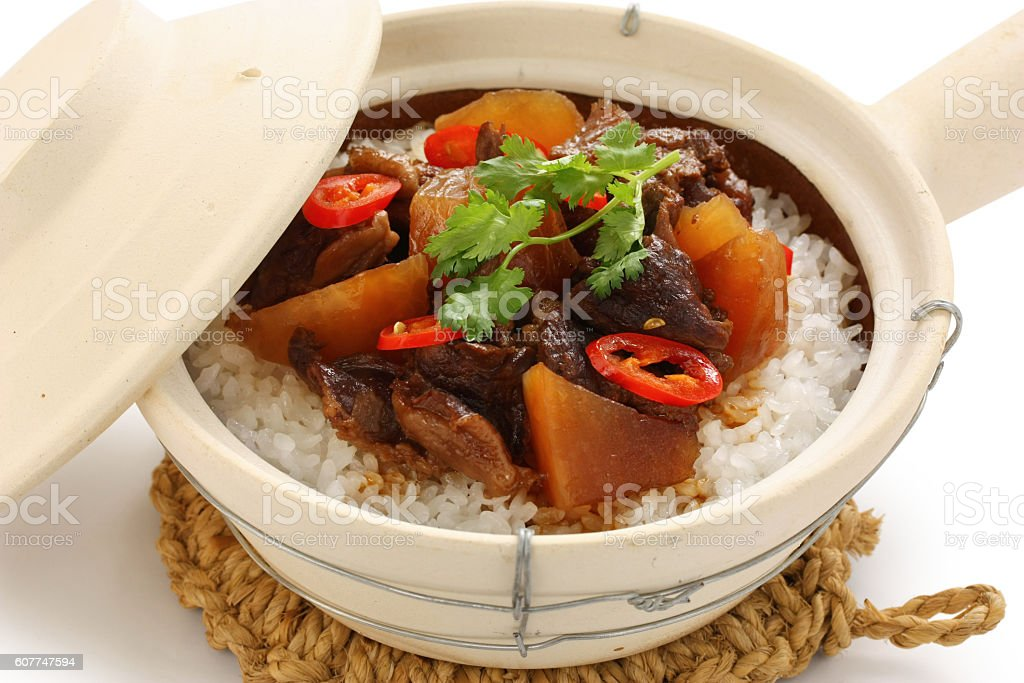 beef  with rice in clay pot, cantonese food stock photo