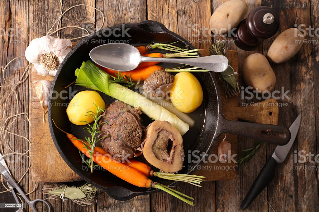 beef with vegetable and broth,pot au feu stock photo