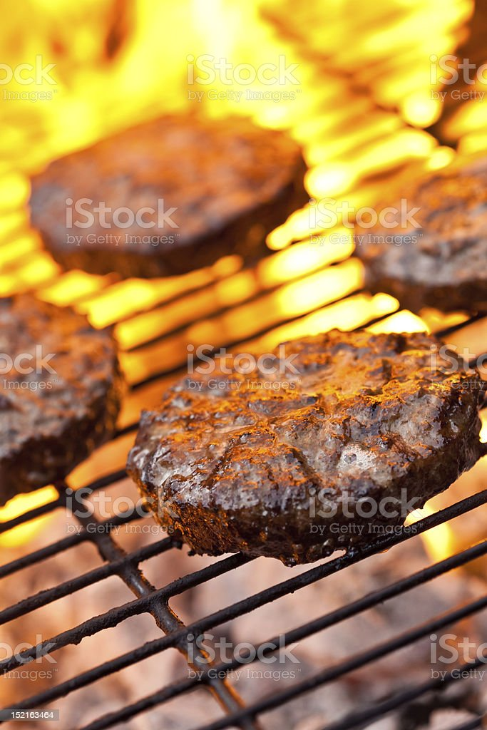 Beefburgers on a BBQ royalty-free stock photo