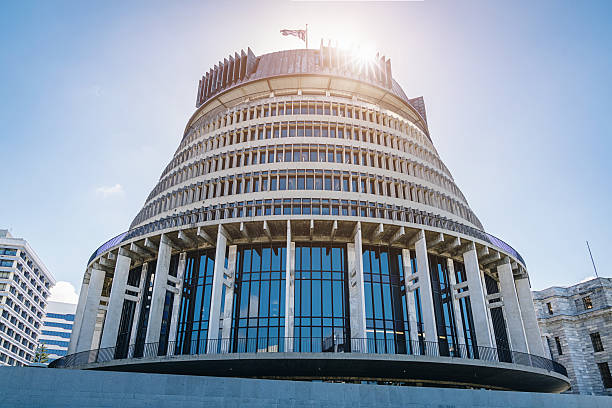 Beehive Wellington against the Sun, New Zealand The Beehive, New Zealand's Parliament Building, against the Sun. Wellington, North Island, New Zealand, Oceania wellington new zealand stock pictures, royalty-free photos & images