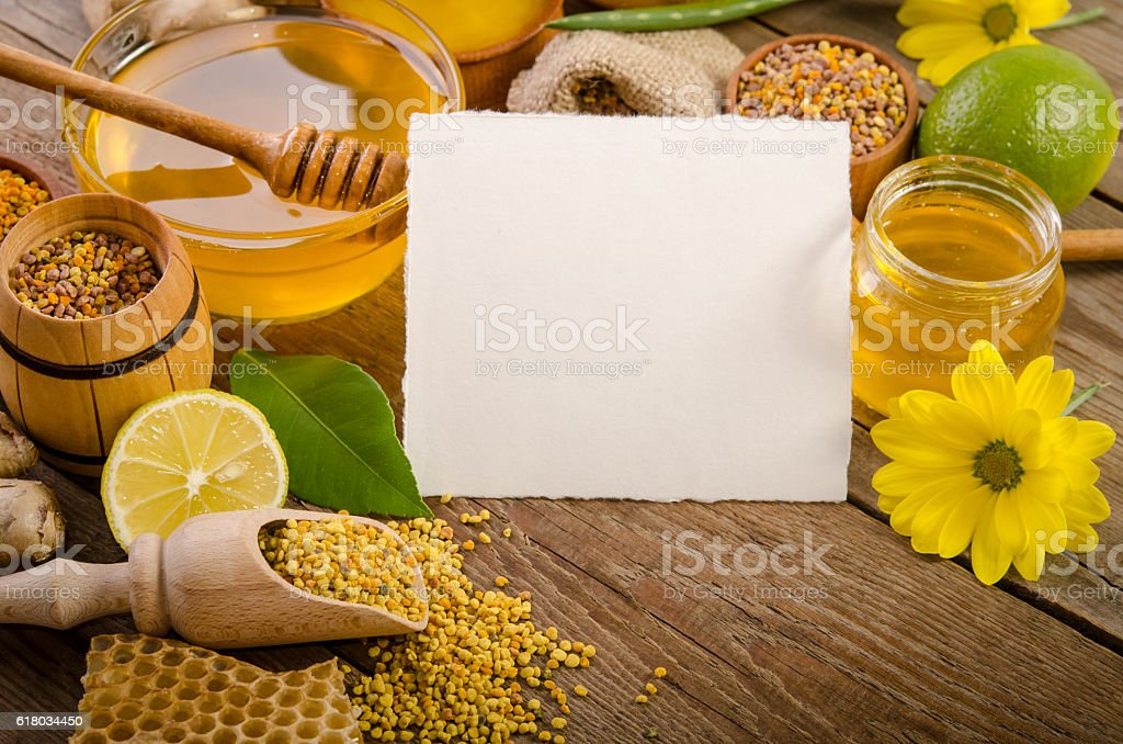 beekeeping products with lemons on a wooden table stock photo