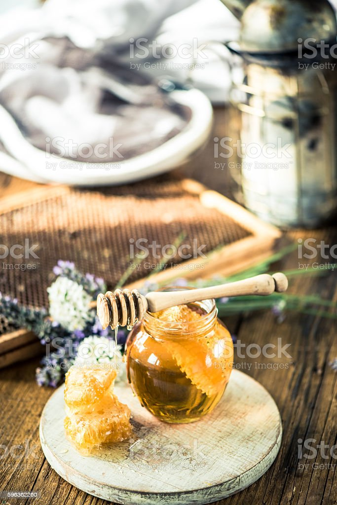 Beekeeping tools and honey royalty-free stock photo