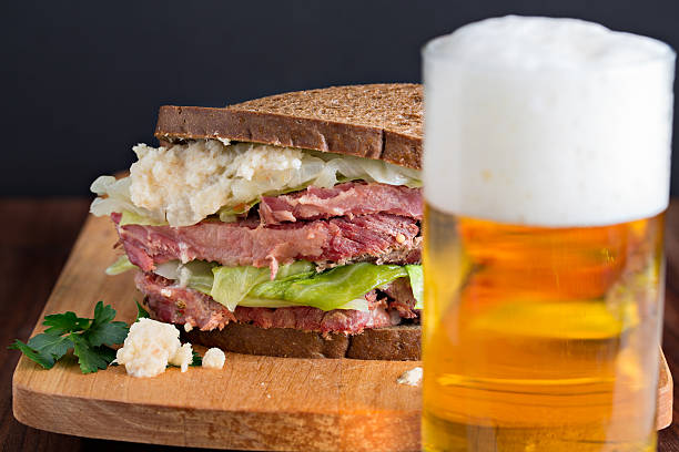 beer and a corned beef sandwich - st patricks day food stock photos and pictures