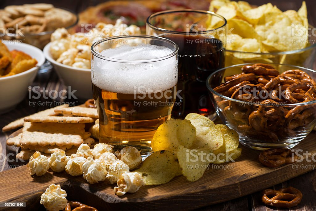 beer and an assortment of snacks stock photo